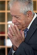 Charlie, age 85, in prayer.