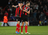 Picture by Tom Smith/Focus Images Ltd 07545141164<br /> 26/12/2013<br /> Tommy Elphick (left) and Simon Francis (right) of Bournemouth celebrate as Matt Ritchie (out of picture) scores to make it 1-0 during the Sky Bet Championship match at the Goldsands Stadium, Bournemouth.