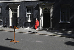 May 24, 2019, London, England, United Kingdom: British Prime Minister Theresa May walks outside 10 Downing Street to make a speech, in London, Britain on May 24, 2019. Theresa May said on Friday that she will quit as leader of the Conservative party on June 7, paving the way for the process of electing her successor. (Credit Image: © Xinhua via ZUMA Wire)
