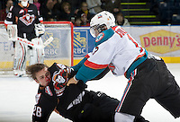 KELOWNA, CANADA, JANUARY 1: Tyrell Goulbourne #12 of the Kelowna Rockets gets in the fact of Collin Bowman #28  of the Calgary Hitmen as the Calgary Hitmen visit the Kelowna Rockets on January 1, 2012 at Prospera Place in Kelowna, British Columbia, Canada (Photo by Marissa Baecker/Getty Images) *** Local Caption ***