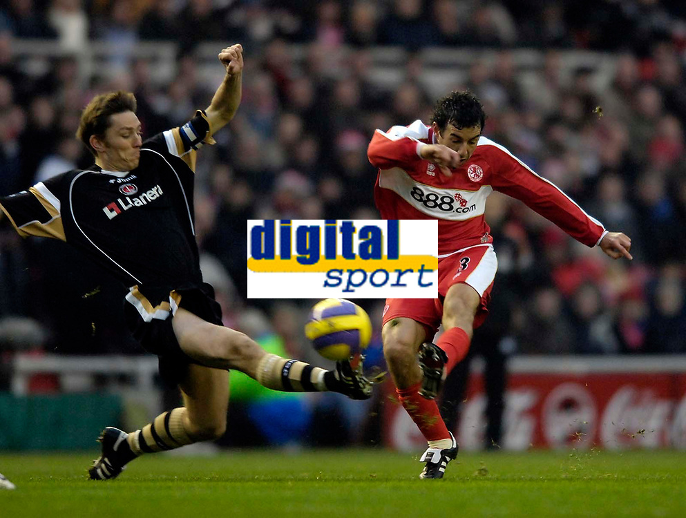 Photo: Jed Wee.<br />Middlesbrough v Charlton Athletic. The Barclays Premiership. 23/12/2006.<br /><br />Middlesbrough's Julio Arca (R) fires a shot in on goal as Charlton's Matt Holland tries to block the shot.