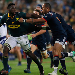 Siya Kolisi of South Africa holds off Gael Fickou of France during the 2nd Castle Lager Incoming Series Test match between South Africa and France at Growthpoint Kings Park on June 17, 2017 in Durban, South Africa. (Photo by Steve Haag Sports)