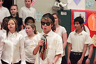 Connor Venia leads the Singing Chargers as they perform Never Say Never during the 'We Will Jingle!' arts concert at Cleveland PK-8 school in Dayton, Wednesday, December 12, 2012.
