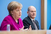 12 MAR 2018, BERLIN/GERMANY:<br /> Angela Merkel (L), CDU, Bundeskanzlerin, und Olaf Scholz (R), SPD, desig. Bundesfinanzminister, waehrend einer Pressekonferenz zum Koalitionsvertrag der CDU/CSU und SPD, Bundespressekonferenz<br /> IMAGE: 20180312-01-049