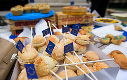 © Licensed to London News Pictures. 12/06/2018. London, UK. EU flags placed in to pies on offer as Pro EU campaigners gather outside the Houses of Parliament in London on the day. The Commons will vote later on whether to give MPs a decisive say on any final deal struck with the EU in the autumn. Photo credit: Ben Cawthra/LNP