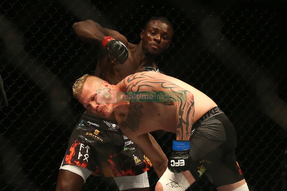 Pietie Coxen (Blue) goes down after a punch from Pupanga Tresor (Red) during the sixth bout of the Extreme Fighting Championships, EFC 52 held at the Grand West Casino in Cape Town, South Africa on the 5th August 2016<br /> <br /> Photo by:   Shaun Roy / Real Time Images