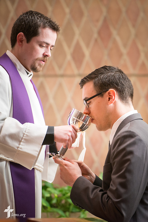 Seminarian Jacob Benson receives the Sacrament during worship at Kramer Chapel at Concordia Theological Seminary, Fort Wayne, Ind., on Wednesday, April 1, 2015. LCMS Communications/Erik M. Lunsford