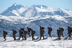Paratroopers assigned to 1st Battalion, 501st Parachute Infantry Regiment, 4th Infantry Brigade Combat Team (Airborne), 25th Infantry Division, U.S. Army Alaska, leave Malemute drop zone after conducting airborne training at Joint Base Elmendorf-Richardson, Alaska, April 13, 2017. The Soldiers of 4/25 belong to the only American airborne brigade in the Pacific and are trained to execute airborne maneuvers in extreme cold weather/high altitude environments in support of combat, partnership and disaster relief operations. (U.S. Air Force photo by Alejandro Pena)