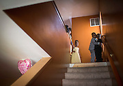 Flower girls and corsage-bearing boys who were part of the ceremony await their cue at the top of the stairs before walking out for a prom send-off party for cousins Jerqwanna Collins and Juavonna Baldwin and their dates Saturday, May 17, 2014 in North Lawndale. (Brian Cassella/Chicago Tribune) B583716572Z.1  ....OUTSIDE TRIBUNE CO.- NO MAGS,  NO SALES, NO INTERNET, NO TV, CHICAGO OUT, NO DIGITAL MANIPULATION...