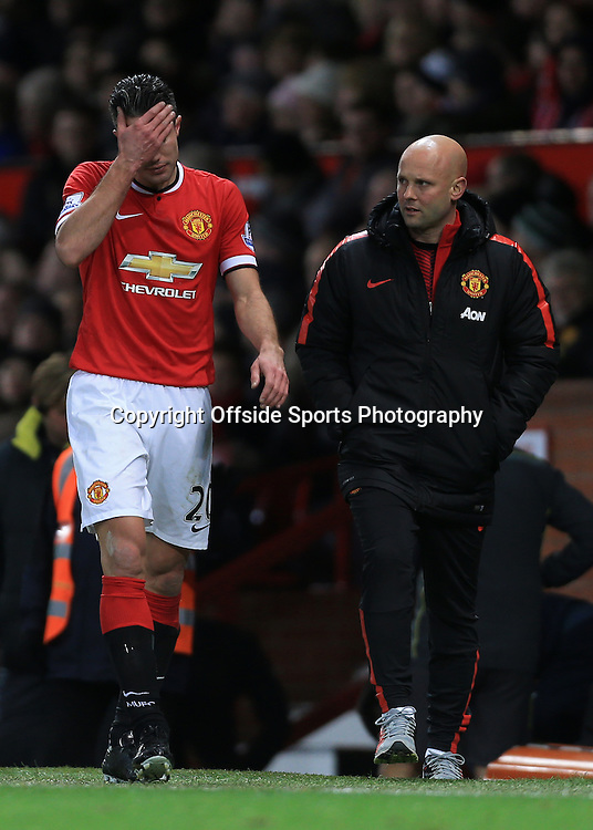 11th January 2015 - Barclays Premier League - Manchester United v Southampton - Robin van Persie of Man Utd looks dejected as he leaves the pitch injured - Photo: Simon Stacpoole / Offside.