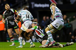 London Irish Winger (#14) Topsy Ojo is tackled by Harlequins replacement (#20) Tom Guest during the second half of the match - Photo mandatory by-line: Rogan Thomson/JMP - Tel: Mobile: 07966 386802 29/12/2012 - SPORT - RUGBY - Twickenham Stadium - London. Harlequins v London Irish - Aviva Premiership - LV= Big Game 5.