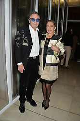 TIM SPICER and MAIA NORMAN at a private view of Isabella Blow: Fashion Galore! held at Somerset House, London on 19th November 2013.