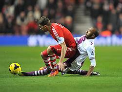 Aston Villa's Fabian Delph fouls Southampton's Jay Rodriguez - Photo mandatory by-line: Alex James/JMP - Tel: Mobile: 07966 386802 04/12/2013 - SPORT - Football - Southampton - St Mary's Stadium - Southampton v Aston Villa - Barclays Premier League