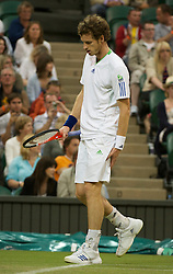 LONDON, ENGLAND - Friday, June 24, 2011: Andy Murray (GBR) feels his hamstring during the Gentlemen's Singles 3rd Round match on day five of the Wimbledon Lawn Tennis Championships at the All England Lawn Tennis and Croquet Club. (Pic by David Rawcliffe/Propaganda)