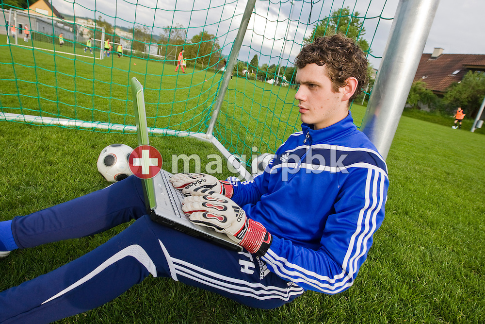 FC Baden A-Junior soccer goalkeeper Marco Maeder of Switzerland types on his laptop while sitting on the ground in a goal surrounded by balls during a training session in Ruetihof near Baden AG, Switzerland, Friday, May 25, 2010. Fifa bans the use of social network platforms like Facebook in their venues during the Fifa World Cup 2010 in South Africa. (Photo by Patrick B. Kraemer / MAGICPBK)