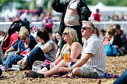 © Licensed to London News Pictures. 05/08/2012. London, UK.     People enjoy the sunny weather whilst watching the Olympics on screen at BT London Live, Hyde Park. Photo credit : Richard Isaac/LNP