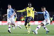 Joao Cancelo (27) of Manchester City is challenged by Dan Agyei (23) of Oxford United during the EFL Cup match between Oxford United and Manchester City at the Kassam Stadium, Oxford, England on 18 December 2019.