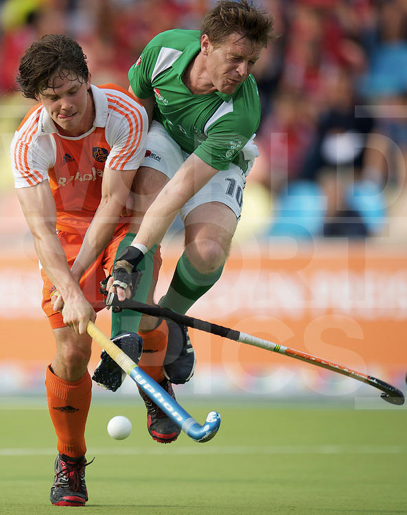 MONCHENGLADBACH - EuroHockey Championship men .Netherlands vs Ireland.foto: Wouter Jolie (orange) and Joseph Brennan (green)..FFU Press Agency  COPYRIGHT FRANK UIJLENBROEK