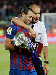 17.08.2011, Camp Nou, Barcelona, ESP, Supercup 2011, FC Barcelona vs Real Madrid, im Bild FC Barcelona's coach coach Pep Guardiola (r) and Javier Mascherano celebrates the victory during Spanish Supercup 2nd match.August 17,2011. EXPA Pictures © 2011, PhotoCredit: EXPA/ Alterphotos/ Acero +++++ ATTENTION - OUT OF SPAIN / ESP +++++