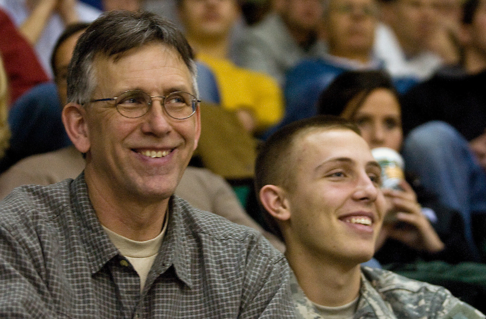 Kevin Brady of Lambertville, N.J. and his son Cadet Wyatt Brady, a geographic information science major, enjoy the Bobcat's comeback run on Saturday, January 26, 2008 in the Convocation Center. Ohio University pulled out a victory by defeating Ball State University 61-59 on a game winning jump-shot by junior forward, Jerome Tillman. ...Dad's weekend: Basketball game at Convo. : Diego James Robles