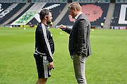 MK Dons manager Karl Robinson chats to Forest player/coach Andy Reid during the Sky Bet Championship match between Milton Keynes Dons and Nottingham Forest at stadium:mk, Milton Keynes, England on 7 May 2016. Photo by Dennis Goodwin.