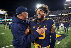 Oct 25, 2018; Morgantown, WV, USA; West Virginia Mountaineers safety Jovanni Stewart (9) celebrates with West Virginia Mountaineers defensive coordinator Tony Gibson after beating the Baylor Bears at Mountaineer Field at Milan Puskar Stadium. Mandatory Credit: Ben Queen-USA TODAY Sports