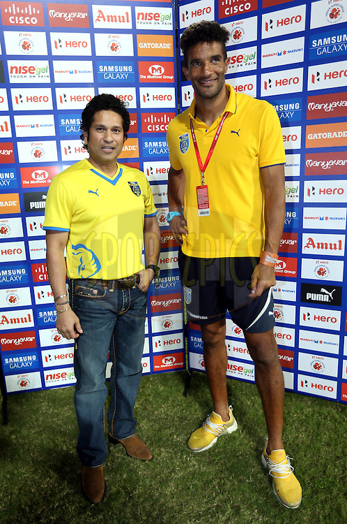 Sachin Tendulkar, Former India cricket player and co-owner of  Kerala Blasters FC and David James head coach of Kerala Blasters FC before the start of the match 49 of the Hero Indian Super League between Kerala Blasters FC and North East United FC held at the Jawaharlal Nehru Stadium, Kochi, India on the 4th December 2014.<br /> <br /> Photo by:  Sandeep Shetty/ ISL/ SPORTZPICS