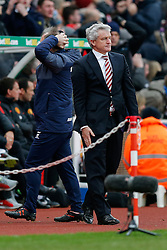 Stoke City Manager Mark Hughes looks frustrated after his side go close to scoring - Photo mandatory by-line: Rogan Thomson/JMP - 07966 386802 - 01/01/2015 - SPORT - FOOTBALL - Stoke-on-Trent, England - Britannia Stadium - Stoke City v Manchester United - New Year's Day Football - Barclays Premier League.