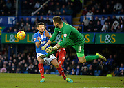 Leyton Orient Goalkeeper Alex Cisak punches clear ahead of Portsmouth striker Gareth Evans during the Sky Bet League 2 match between Portsmouth and Leyton Orient at Fratton Park, Portsmouth, England on 6 February 2016. Photo by Adam Rivers.