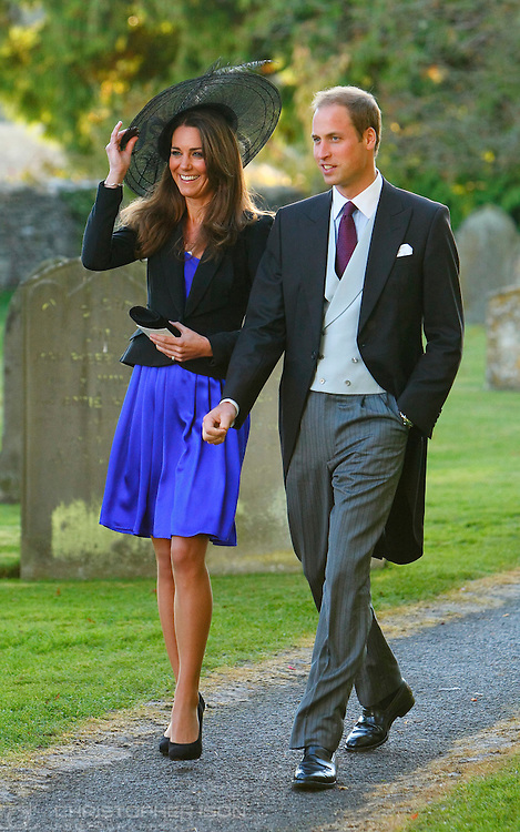 Prince William and Kate Middleton leave the wedding of their friends Harry Mead and Rosie Bradford in the village of Northleach, Gloucestershire.