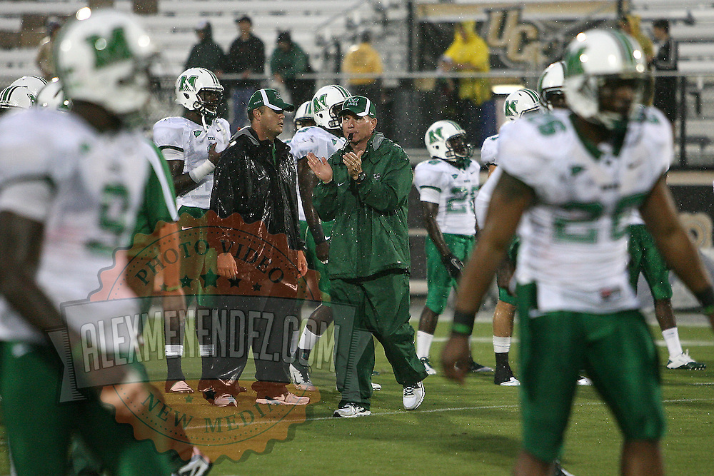 Marshall Head Coach Doc Holliday warms up his players  prior to an NCAA football game between the Marshall Thundering Herd and the Central Florida Knights at Bright House Networks Stadium on Saturday, October 8, 2011 in Orlando, Florida. Thunderstorms are expected for this evenings game.(Photo/Alex Menendez)