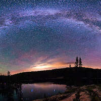 The Milky Way arcs over Bear Lake in Medicine Bow National Forest, Wyoming in late July 2015.<br />