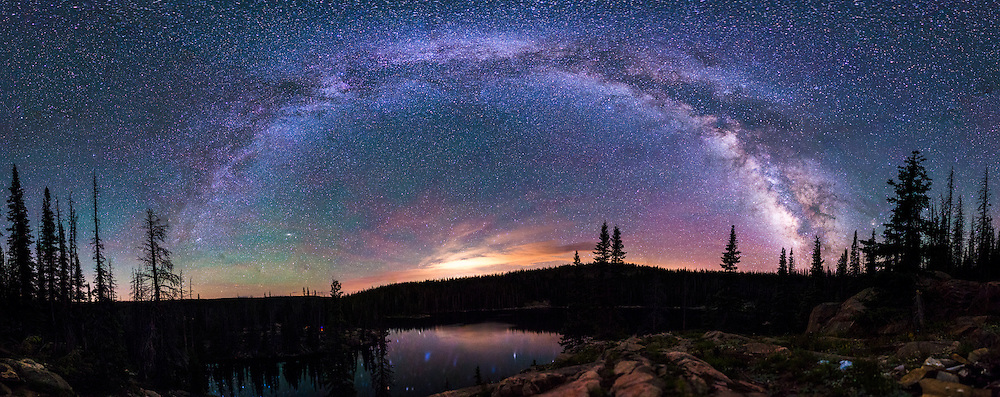 The Milky Way arcs over Bear Lake in Medicine Bow National Forest, Wyoming in late July 2015.<br /> <br /> After spending about a week in Denver with my father, we packed up and headed north to shoot the sunset and leave Colorado with Wyoming being our destination. <br /> <br /> Neither of us had been to Wyoming before, and I was not positive of where we'd be spending the night...although I had a few ideas. We wound up in Medicine Bow National Forest after dark, making me again grateful for the lightbar. I got out of the Jeep to check the posted map, just as I was walking back to the Jeep I saw snow flurries in the beam...welcome to Wyoming. <br /> <br /> After driving west a bit more I found the dirt road I was looking for, and after what seemed like forever (probably only 30 minutes), we arrived at what looked like where we would be setting up camp...but it was someone else's campsite. A few minutes later we came across Bear Lake, and I found a place to park the Jeep by a small stream (most peaceful sound to fall asleep to).<br /> <br /> Waking up in a new area when you don't arrive until after dark is always a nice surprise. Driving in after dark generally means having no clue what your surroundings look like except for a slice of light attached to the windshield.<br /> <br /> I took this photo on our second night here, climbing up on the ridge that overlooks the lake (as well as our campsite), provided a stunning view of the Milky Way. I attempted to stitch this panorama back in July when I shot it, but the programs did not like it. I figured I'd give it a go the other day and am thrilled with the results! I need to get back out to the mountains....<br /> <br /> 15&quot; f/2.2 ISO 6400