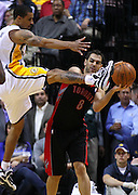 April 09, 2012; Indianapolis, IN, USA; Toronto Raptors point guard Jose Calderon (8) tries to get the ball around Indiana Pacers shooting guard George Hill (3)at Bankers Life Fieldhouse. Indiana defeated Toronto 103-98. Mandatory credit: Michael Hickey-US PRESSWIRE