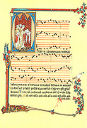 Page from the Montpellier Codex, a collection of 13th-14th century music manuscripts of the Notre Dame (Old French) school of Paris.  Page of music decorated with initial letter O enclosing monks chanting from an antiphonal.  Gregorian chant or plainsong, the oldest music of the Christian Church.