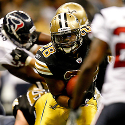 September 25, 2011; New Orleans, LA, USA; New Orleans Saints running back Mark Ingram (28) runs for a touchdown against the Houston Texans during the fourth quarter at the Louisiana Superdome. The Saints defeated the Texans 40-33. Mandatory Credit: Derick E. Hingle