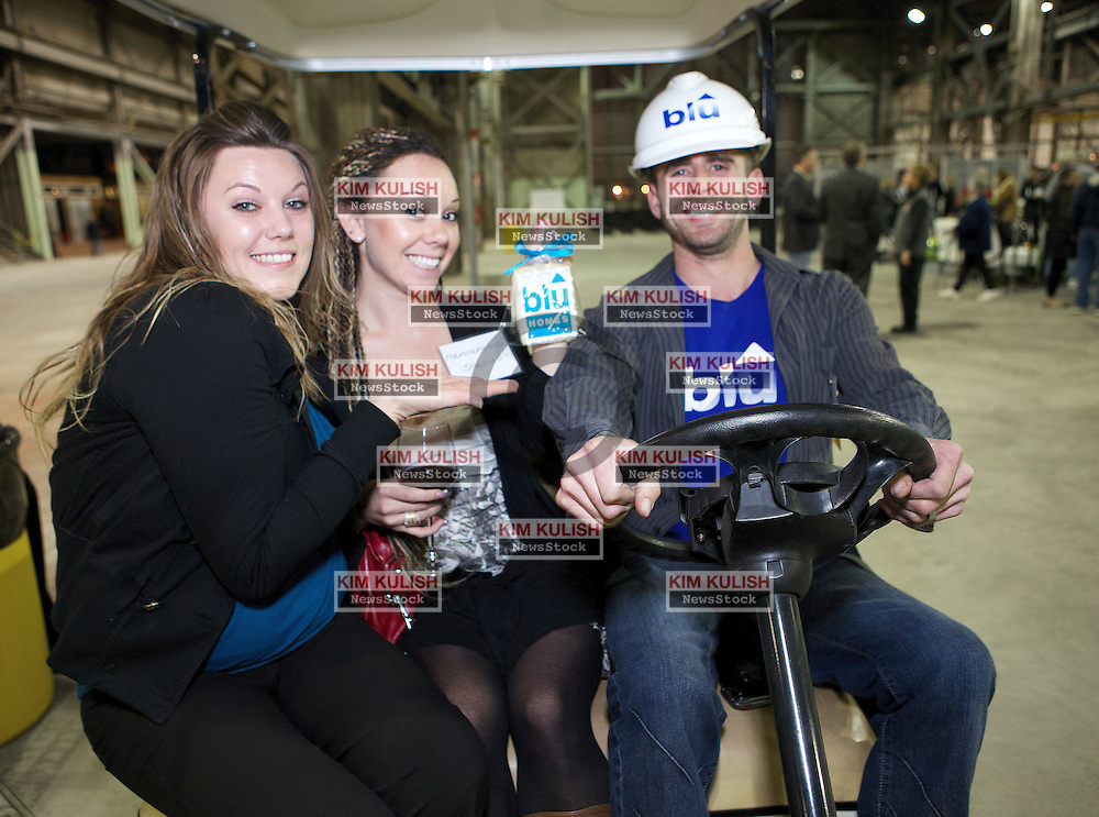 Daisha Downey, Hannahlind Shapiro and Trevor Bach are all smiles in their cart as  Blu Homes opens their West Coast factory on Mare Island in Vallejo, California Dec. 1, 2011.  Over 400 guests attended a ribbon cutting ceremony at the 250,000-square-foot facility.