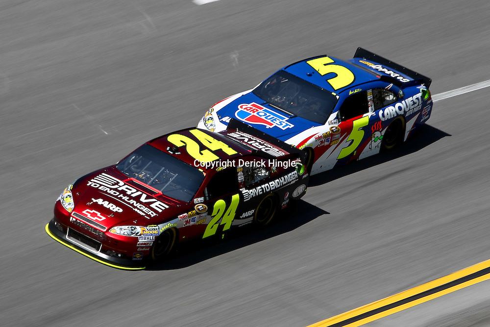 April 17, 2011; Talladega, AL, USA; NASCAR Sprint Cup Series driver Mark Martin (5) bump drafts with Jeff Gordon (24) during the Aarons 499 at Talladega Superspeedway.   Mandatory Credit: Derick E. Hingle