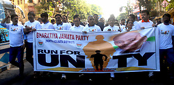 October 31, 2018 - Kolkata, West Bengal, India - West Bengal Bharatiya Janta Party or BJP President Dilip Ghosh (in middle)  along with other leaders and activist take part in the ''Run for Unity'' marathon on the birth anniversary of the India first Home Minister Sardar Vallabhbhai Patel. (Credit Image: © Saikat Paul/Pacific Press via ZUMA Wire)