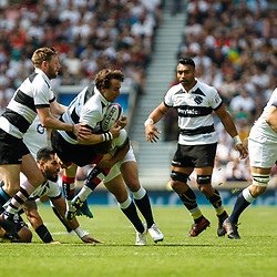 Rhodri Williams of the Barbarians gets tackled
