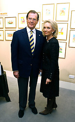 Actor ROGER MOORE and his wife KIKI  THOLSTRUP at an exhibition of postcards by the late Donald McGill hosted by Michael Winner at Chris Beetles, 8&10 Ryder Street, London SW1 on 14th March 2006.<br />