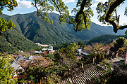 "Kumano Nachi Taisha shrine was built in homage to Nachi-no-Taki waterfall's kami (spirit god). Don't miss the iconic view of thundering Nachi-no-Taki waterfall (133 m, Japan's tallest) paired with Seiganto-ji pagoda, in Nachikatsuura, Higashimuro District, Wakayama Prefecture, on the Kii Peninsula, Honshu, Japan. Kumano Nachi Taisha shrine fuses Buddhist and Shinto influences along the 1000+ year pilgrimage routes of Kumano Kodo. For most of their history, the Buddhist Seiganto-ji and Shinto Kumano Nachi Taisha shrine functioned as one religious institution. The ""Sacred Sites and Pilgrimage Routes in the Kii Mountain Range"" form an impressive entry on UNESCO's List of World Heritage Sites. Access: by bus from Nachi Station (20 min) or Kii-Katsuura Station (30 min). Ask driver to stop at base of the Daimonzaka trail (""Daimonzaka"" stop); or at the entrance to Nachi Waterfall (""Taki-mae""); or at the bus terminus 10 minutes climb below Nachi Shrine (""Nachi-san""). Cars can park at Seigantoji Temple. I recommend this remarkably scenic, short walk (3.5 km with 265 meters gain): starting from Daimon-zaka bus stop, ascend a stone-paved path, humbled by massive evergreens, up to the gates of Nachi Taisha shrine, descend to Seiganto-ji pagoda, then to the falls, just below Taki-mae bus stop."