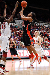 February 24, 2011; Stanford, CA, USA;  Oregon St. Beavers guard/forward Earlysia Marchbanks (15) shoots over Stanford Cardinal forward Chiney Ogwumike (13) during the first half at Maples Pavilion.
