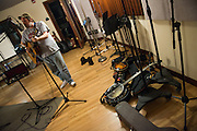 Charles Stantonsings and plays the guitar during a recording session with his band, Controlled Folly at MDIA Sound.