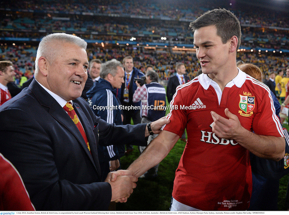 6 July 2013; Jonathan Sexton, British & Irish Lions, is congratulated by head coach Warren Gatland following their victory. British & Irish Lions Tour 2013, 3rd Test, Australia v British & Irish Lions. ANZ Stadium, Sydney Olympic Park, Sydney, Australia. Picture credit: Stephen McCarthy / SPORTSFILE