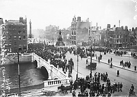 O'Connell Bridge and Sackville (O'Connell) St, showing the aftermath of the 1916 Rising. (Part of the Independent Newspapers Ireland/NLI Collection)