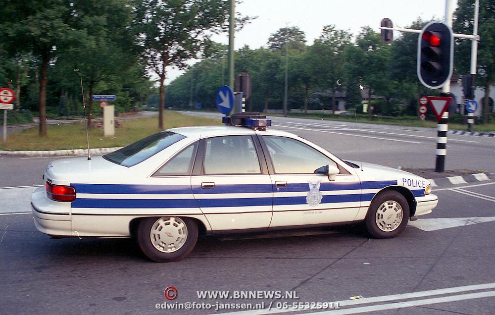 NLD/Zeist/19930609 - Amerikaanse militairen gaan weg uit Soesterberg, politie auto