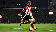 John Swift prepares a ball into the area during the Sky Bet Championship match between Brentford and Hull City at Griffin Park, London, England on 3 November 2015. Photo by Michael Hulf.