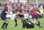 18/05/2002.Sport -Rugby Union- Zurich Championship Quarter final.Gloucester vs Newcastle.Ed Pearce, charges the gap between Hugh Vyvyan and Steve Brotherstone..[Mandatory Credit, Peter Spurier/ Intersport Images].