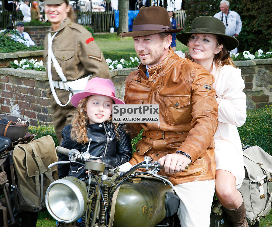 Geri Halliwell with her new husband Christian Horner posing for family photos at the Goodwood Revival 2015, Goodwood Revival 12th September, Day 2. Chichester, West Sussex. (c) SAM TODD | SportPix.org.uk